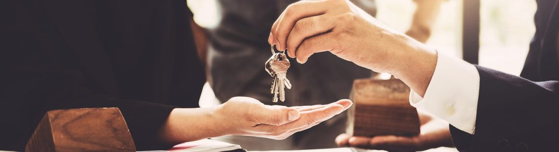 Agents are giving house keys of customer and holding dollar us b